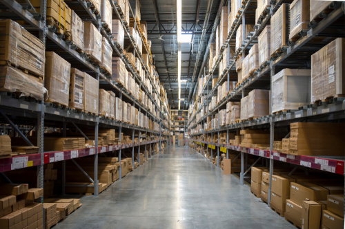 warehouse aisle with stacked cardboard boxes