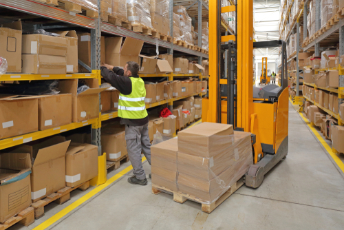 worker picking in fulfillment warehouse