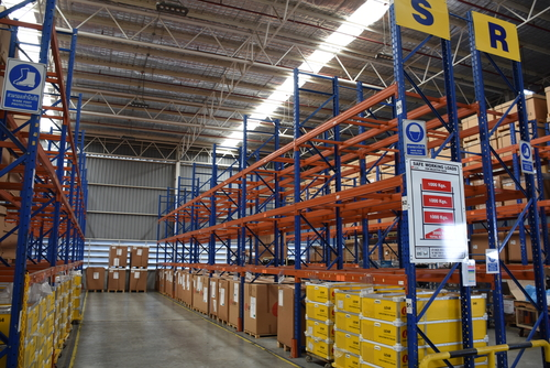 warehouse interior showing various racking systems