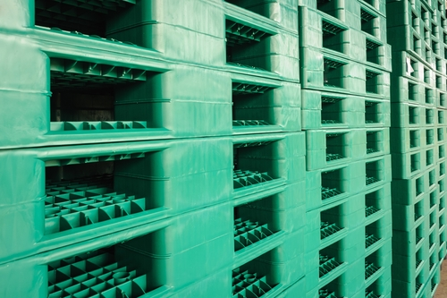 Green plastic pallets in warehouse