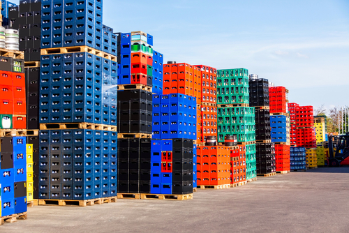 several stacks colorful beverage bottle crates