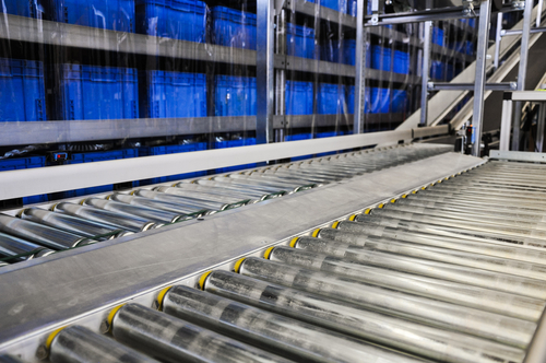 Conveyer-belt-showing-blue-plastic-shipping-containers