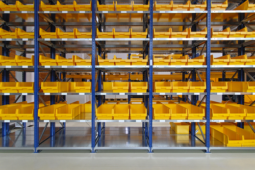 Yellow-AkroBins-shown-on-shelves-in-warehouse