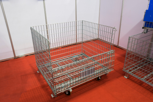 isolated-wire-basket-on-red-flooring