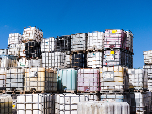large-stack-of-IBC-tote-bulk-containers