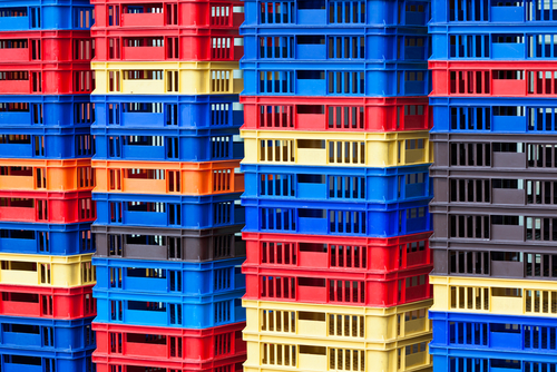 bright plastic containers in piles