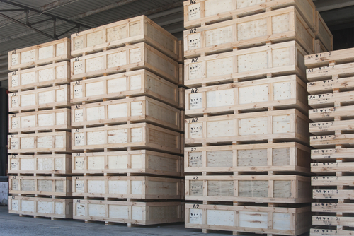 wooden cargo cases in warehouse