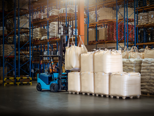 forklift handling jumbo bags in warehouse