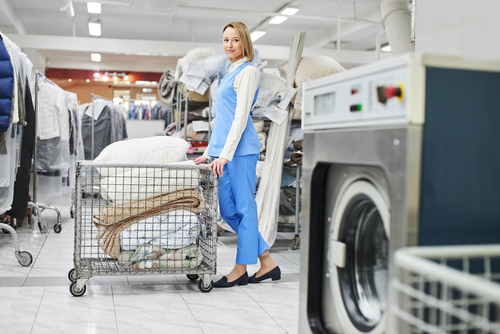 laundry worker cleaning basket