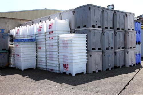 large plastic totes in yard