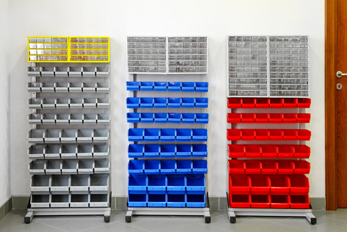 Colorful plastic shelves organizer in work shop