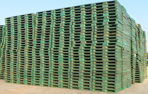 green plastic pallets stacked