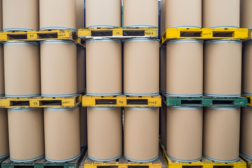 fiber barrels on warehouse shelving