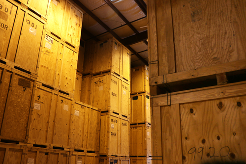 large warehouse of wooden storage crates