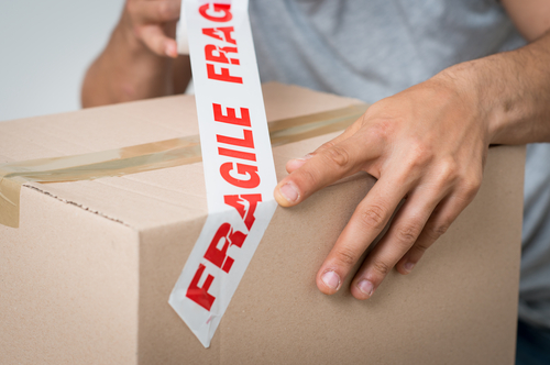 packing cardobard box with fragile tape