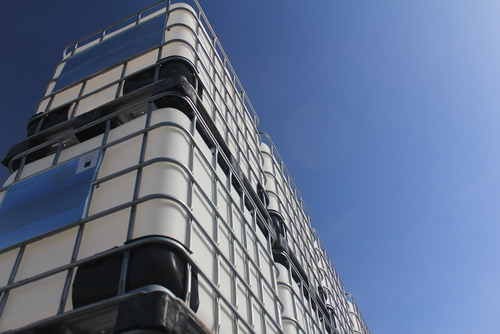 stacked IBCs under blue sky