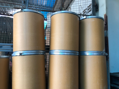stacks of fiber barrels in warehouse
