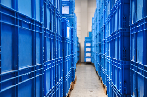 blue plastic containers in warehouse