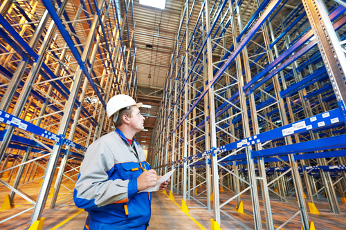 warehouse worker in front of stack racks