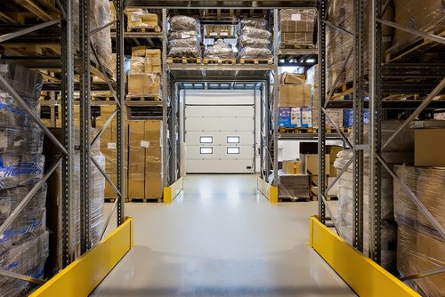 Entrance to a huge warehouse with metal rack