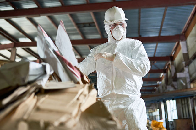 factory worker wearing biohazard suit