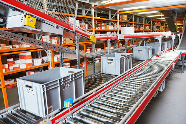 warehouse containers on conveyer belt