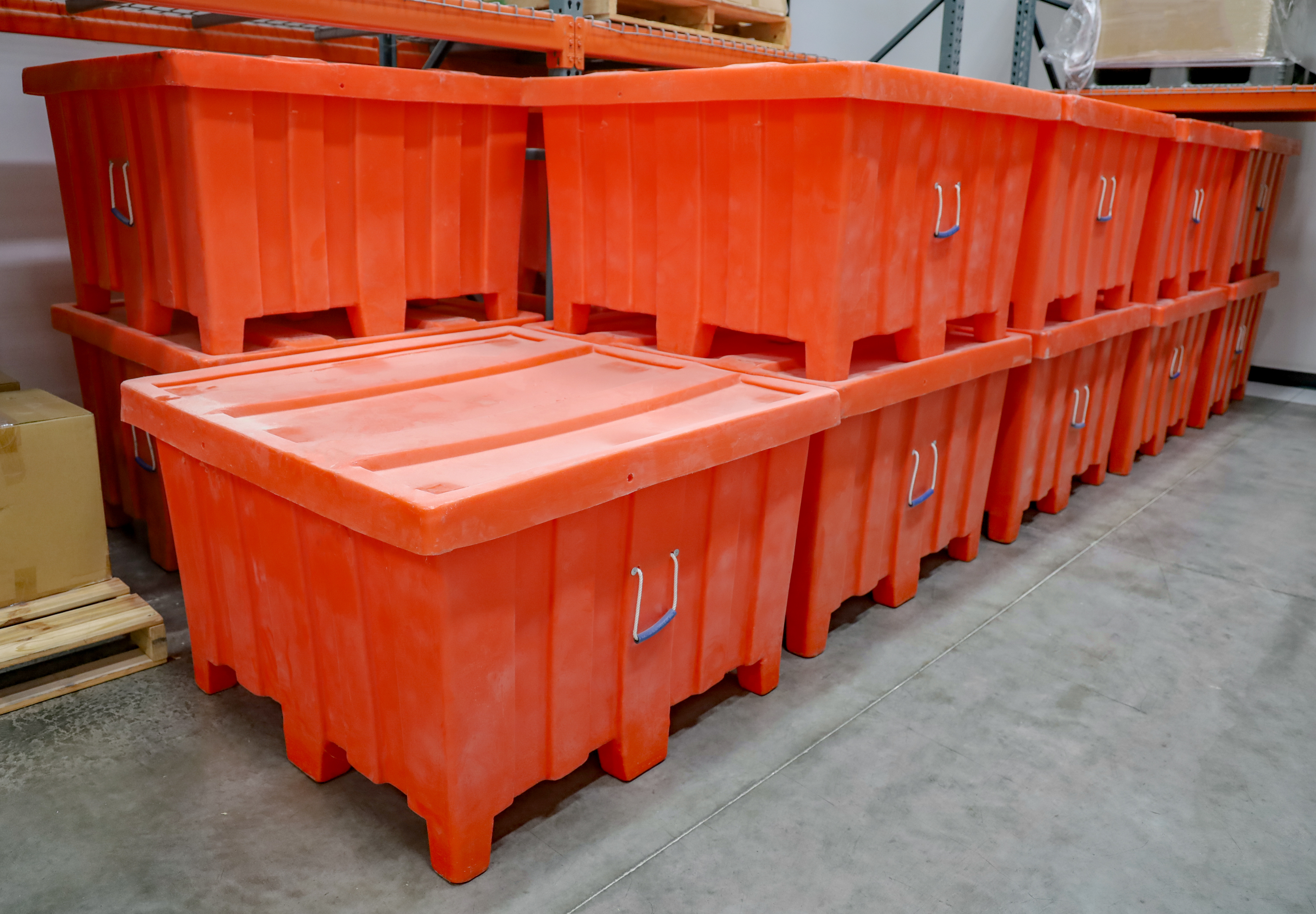 Large orange bulk containers with lids