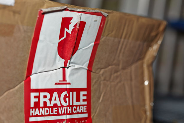 damaged box marked with fragile sticker