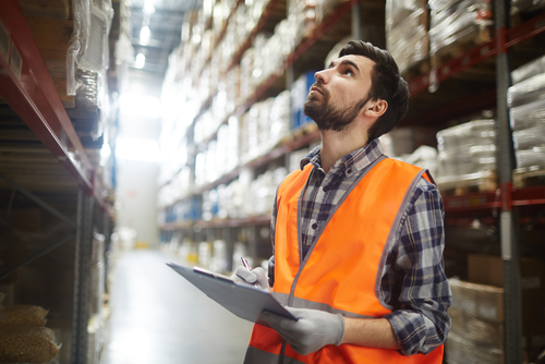 manager reviewing warehouse inventory