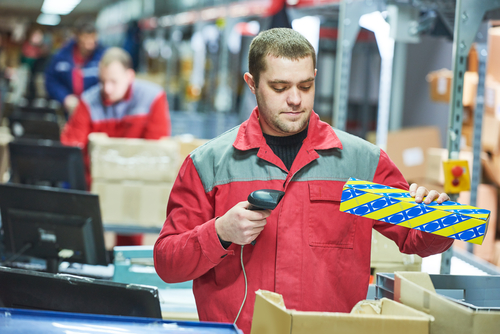 warehouse worker scanning package