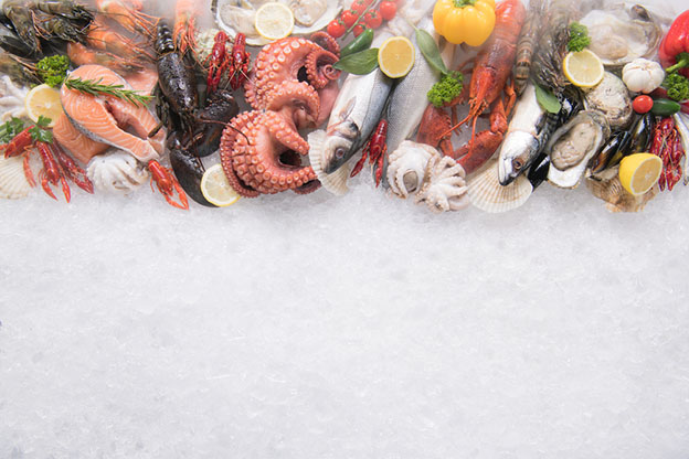 Top view of variety of fresh fish and seafood
