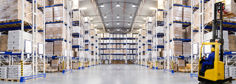 a distribution warehouse with high shelves and a forklift