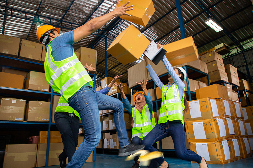 warehouse workers with boxes falling on them