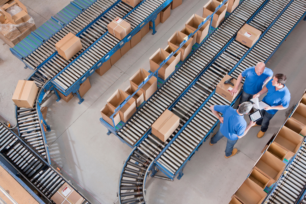 an aerial view of conveyor belts and workers in a warehouse