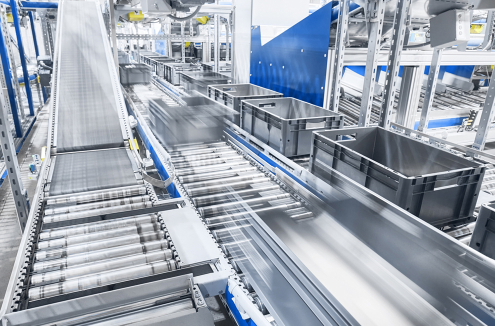 a conveyor with bins in motion