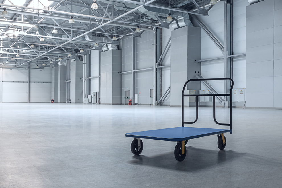 a lone cart inside an otherwise empty warehouse