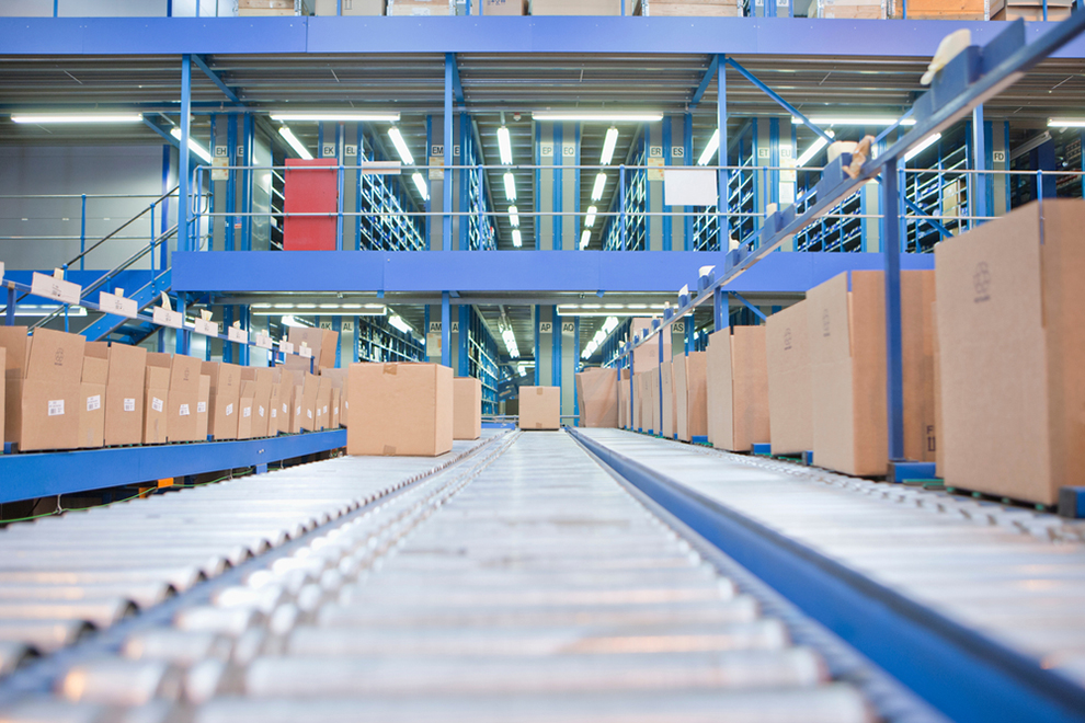 a head on view of boxes on a conveyor