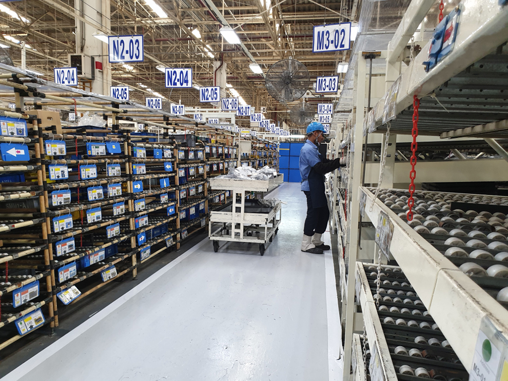 a worker picking product in a warehouse