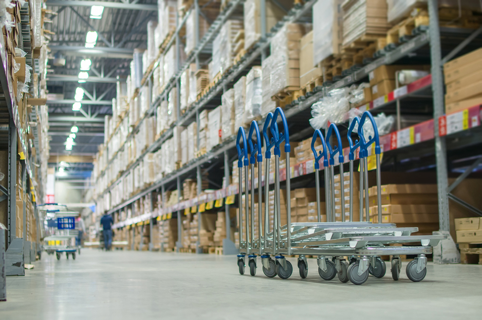 a warehouse with stack racks holding boxes