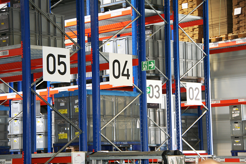 a few aisles of stack racks in an industrial warehouse