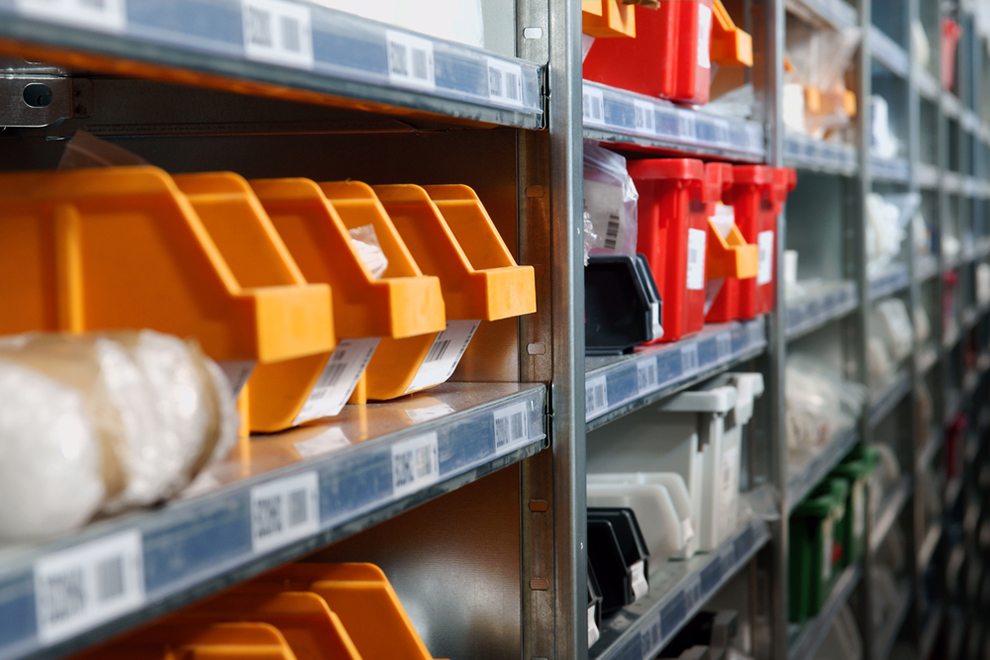 a close up of racks with small bins for components and small parts
