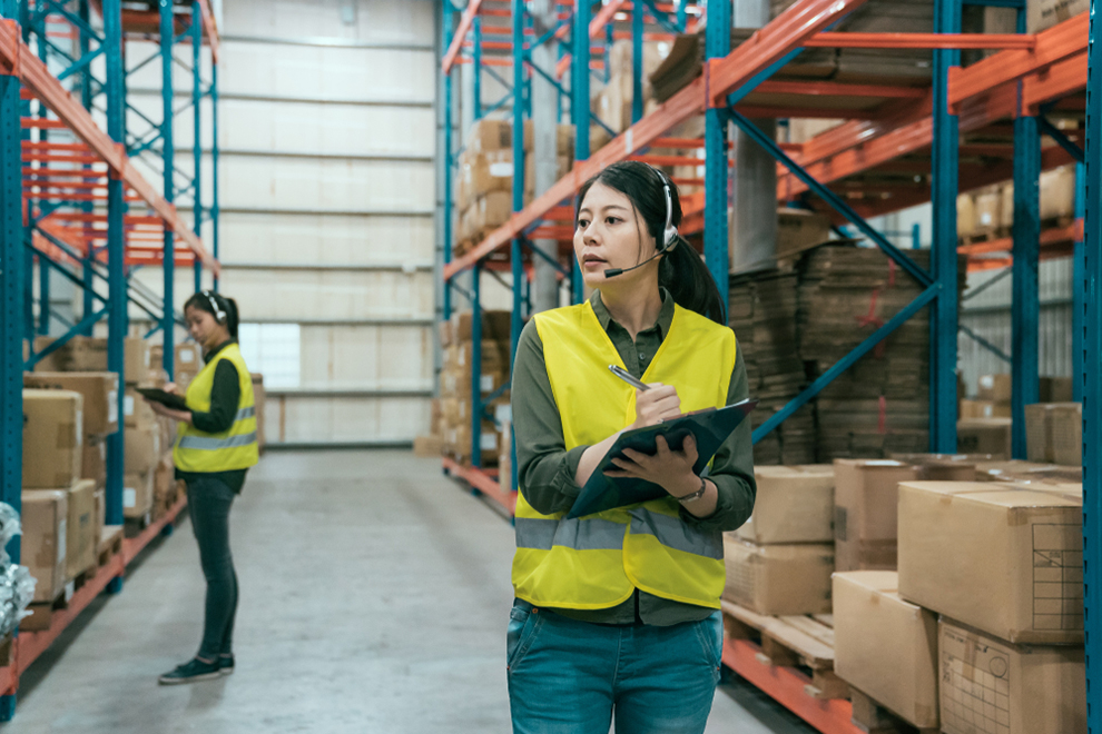 a worker with a headset taking inventory in a warehouse
