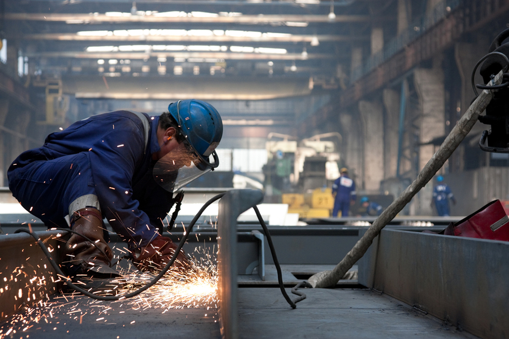 a worker welding with a protective mask