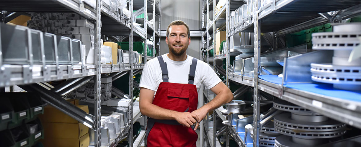 a friendly worker in a parts warehouse